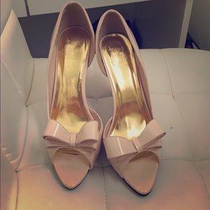Open toe cream shoes